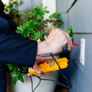 AAA House Manager testing an outlet
